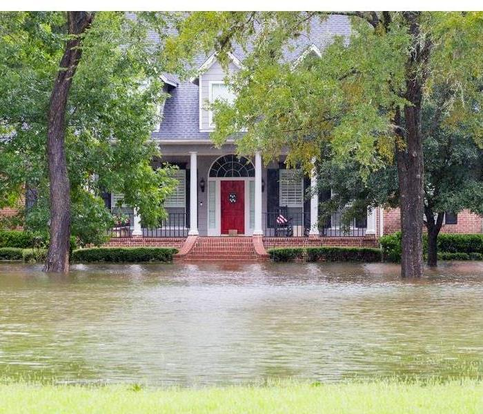 Storm Damage How Landscaping Can Help Protect a Home From Flooding